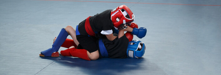 Photo sur Plexiglas Combat Banner. Martial arts training. Two boys are fighting
