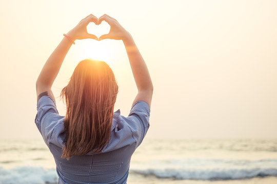 beautiful and young woman depicts the heart Rukmi on the beach