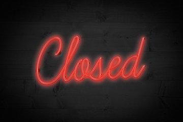 closed sign against black wood