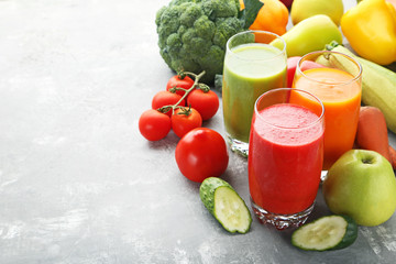 Wall Mural - Vegetables smoothie in glasses on grey wooden table
