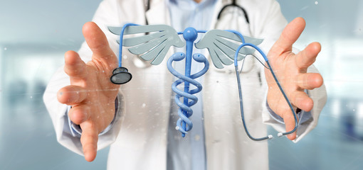 Doctor holding a 3d redering medical cadaceus and stethoscope