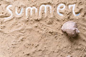 Summer inscription on a sandy background. The concept of travel