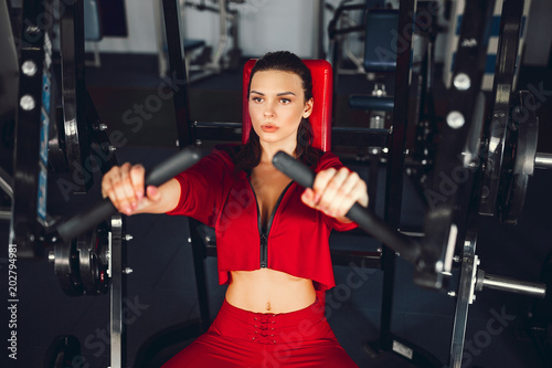 sexy girl doing exercises in her pectoral muscles in