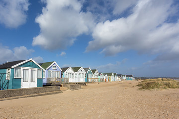 Colourful wooden beach huts on Hengistbury Head on the south coast of britain