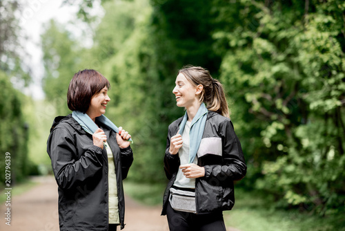 Two sports women talking in the park