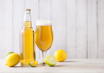 Papiers peints Biere, Cidre Bottle and glass of lager beer with lemon and lime