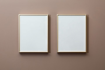 Two white frames on the wall