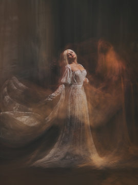 The legend of the Banshee fairy. Pale girl blonde, like a ghost, in a white vintage dress, flies, hovers in space. Branch of the soul. Light angel. Gothic, art photo of the sorceress and the magician