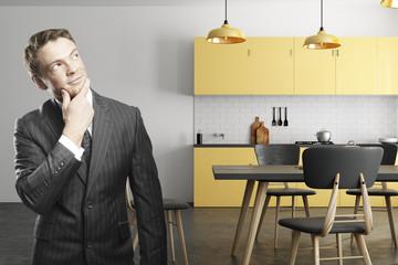 Caucasian businessman in kitchen interior