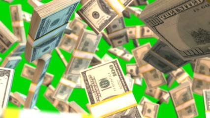 Falling dollar bills on green creen