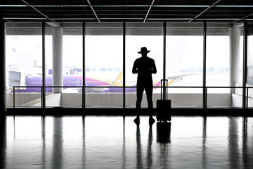 Man in hat in airport