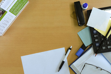 Office workspace, desktop office accessories, mess, wooden table, text space