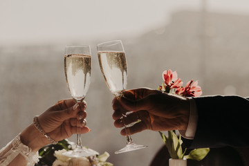 Young coupe in love have romantic date in luxurious restaurant, clink glasses with sparkling white wine or champagne, celebrate their engagement