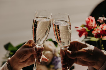 Champagne glasses during toast at party. Romantic dinner or date with champagne glasses. Newlyweds have celebrate wedding party. Marriage concept