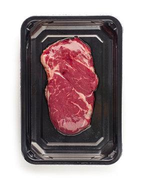 raw beef steak in vacoom package
