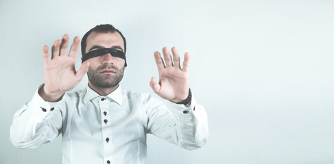Businessman with black tape closed his eyes.