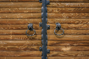 Wooden pine gate with iron elements