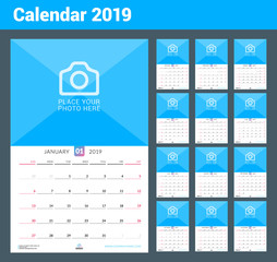 Wall calendar for 2019 year. Vector design print template with place for photo. Week starts on Sunday. Set of 12 pages. Portrait orientation