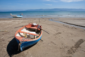 Fisherboats at Kavos beach in Corfu, Greece