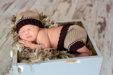 Newborn baby boy, sleeping happily