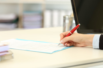 Executive hand signing a form or contract