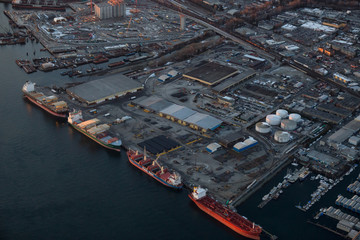 Vancouver, British Columbia, Canada - February 22, 2018: Aerial view of the industrial area in the city during a sunny sunset.