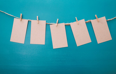 Hanging vintage label tags on a blue background