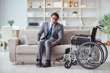 Dsabled businessman on wheelchair working home