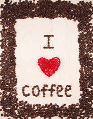 "Inscription ""I love coffee"" made from coffee beans and red wicker rattan heart on wooden background"