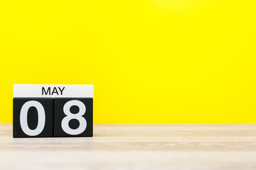 May 8th. Day 8 of may month, calendar on yellow background. Spring time, empty space for text