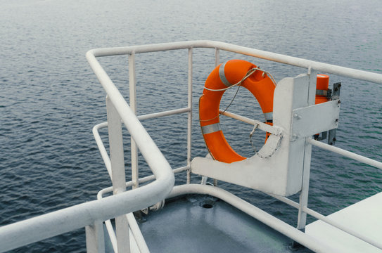 view from wing of ocean ship at sea or sailing through calm ocean. Freedom of endless ocean. orange Lifebuoy is ready for emergency use if man overboard.