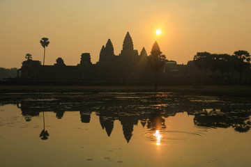 Angkor Wat Temple reflected on the lake at sunrise in Siemp Reap, Cambodia. Unesco World Heritage Site. Ancient landmark, travel destination, tourism concept