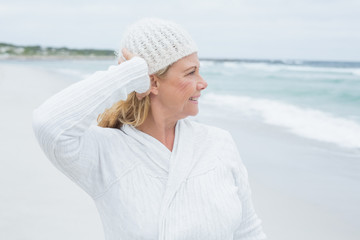 Senior woman looking away at beach