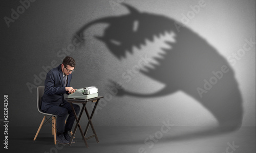 little hard worker afraid of scary monster shadow fotolia com の
