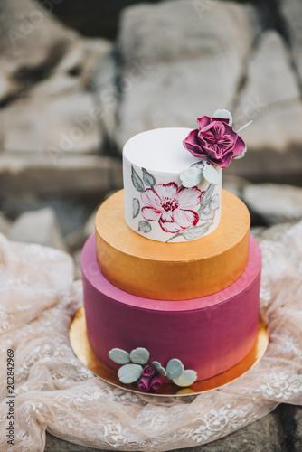 Elegant Modern Three Tier Burgundy Gold And White Wedding Cake