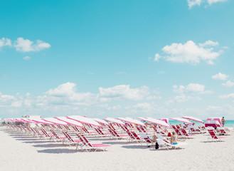 Miami Beach with beach umbrellas and sun loungers