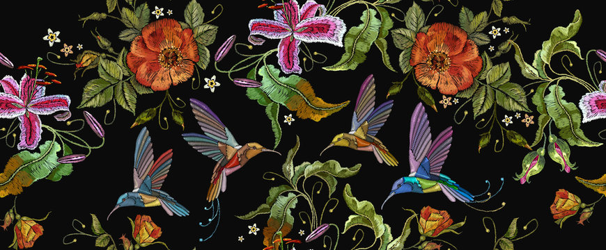 Beautiful bouquet and tropical humming bird pattern. Decorative floral roses embroidery. Embroidery humming birds, orchid and red roses seamless pattern
