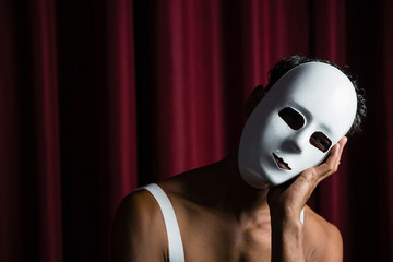 Artist wearing white mask on his face