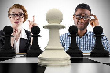 Composite image of business people with chessboard against white background with vignette