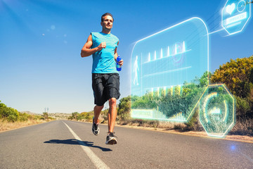 Athletic man jogging on open road holding bottle  against fitness interface
