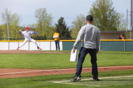 Baseball coach standing at third base