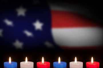 Candles on black background against highly detailed 3d render of an american flag