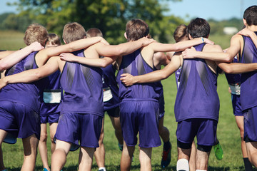 Boys on a team in a huddle
