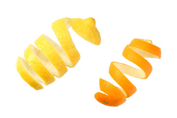 fresh orange and lemon peels isolated on white background top view