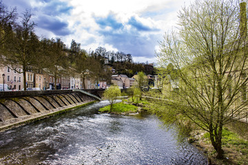 Looking Down the Alzette River with Spring Trees Blooming on Each Side in Luxembourg City, Luxembourg, Horizontal Orientation