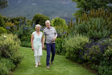 Senior couple walking in lawn