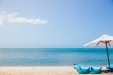 Beach chairs with umbrella and beautiful beach