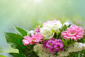 White roses and pink gerbera bouquet.