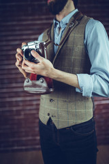 Midsection of man with camera
