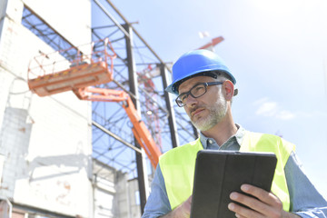 Construction supervisor inspecting building site